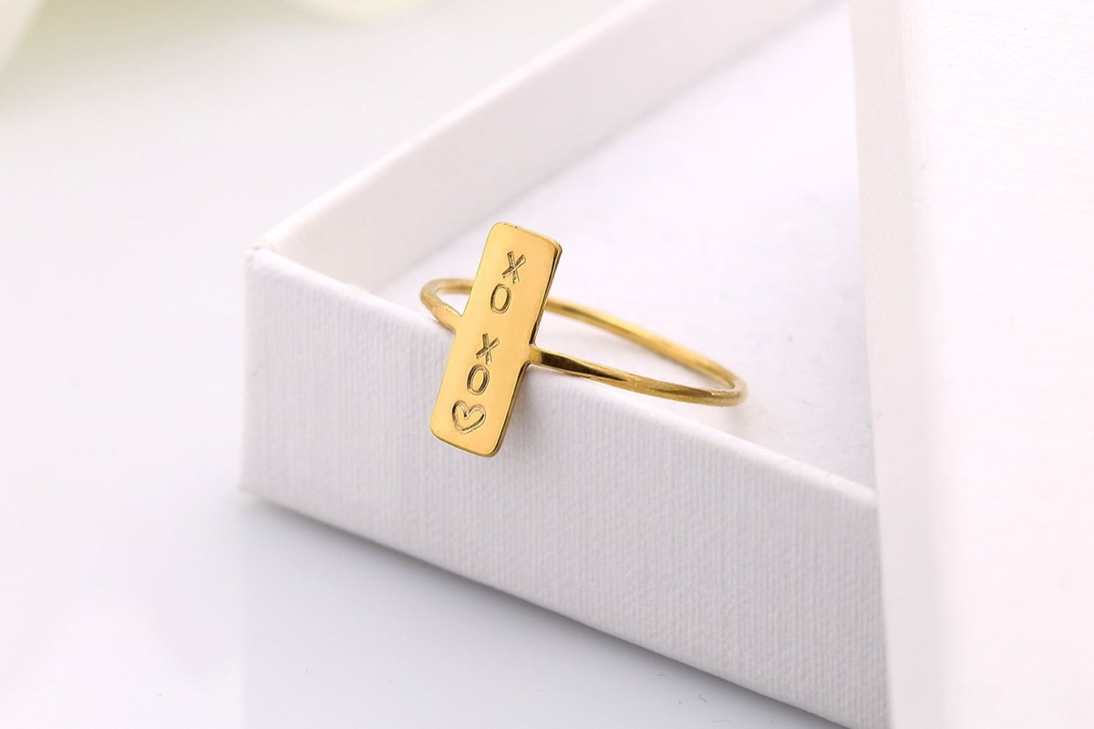 Engraved gold bar ring in box