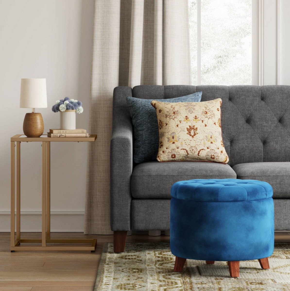 living room with blue tufted ottoman
