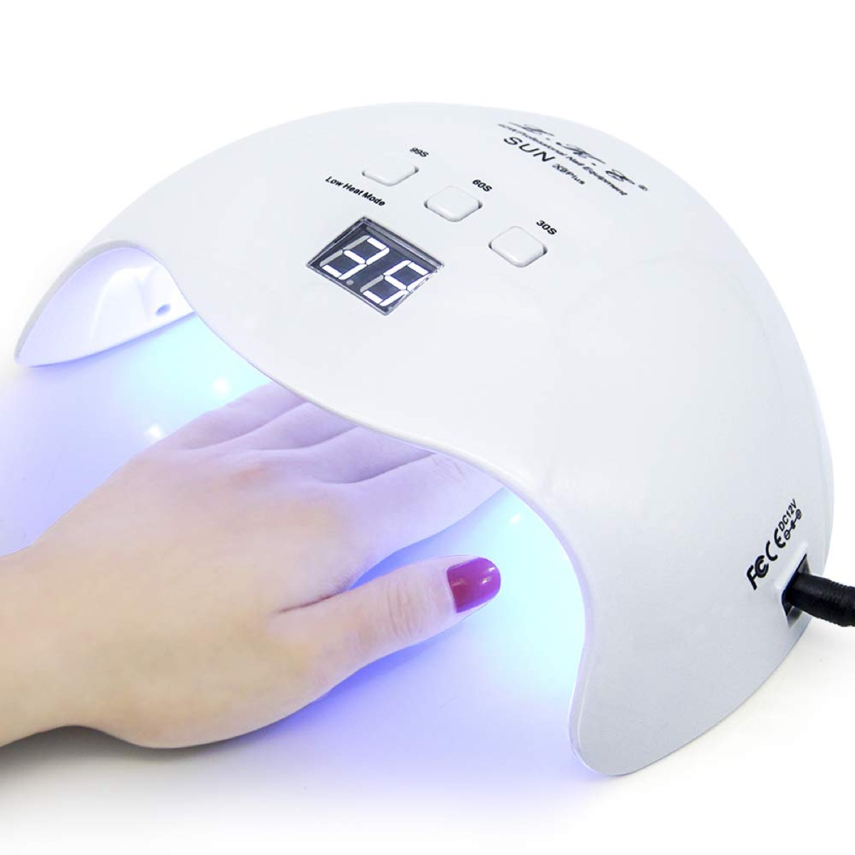 Hand in gel nail dryer