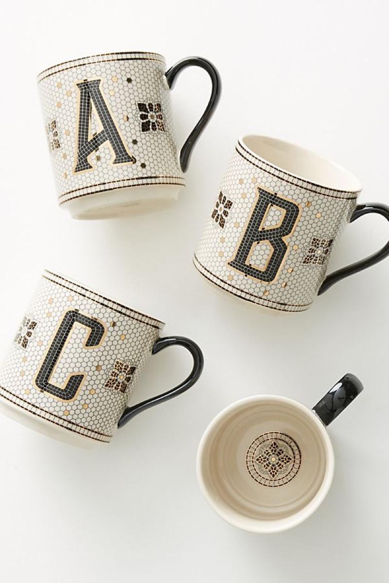 A,B,C mugs on table