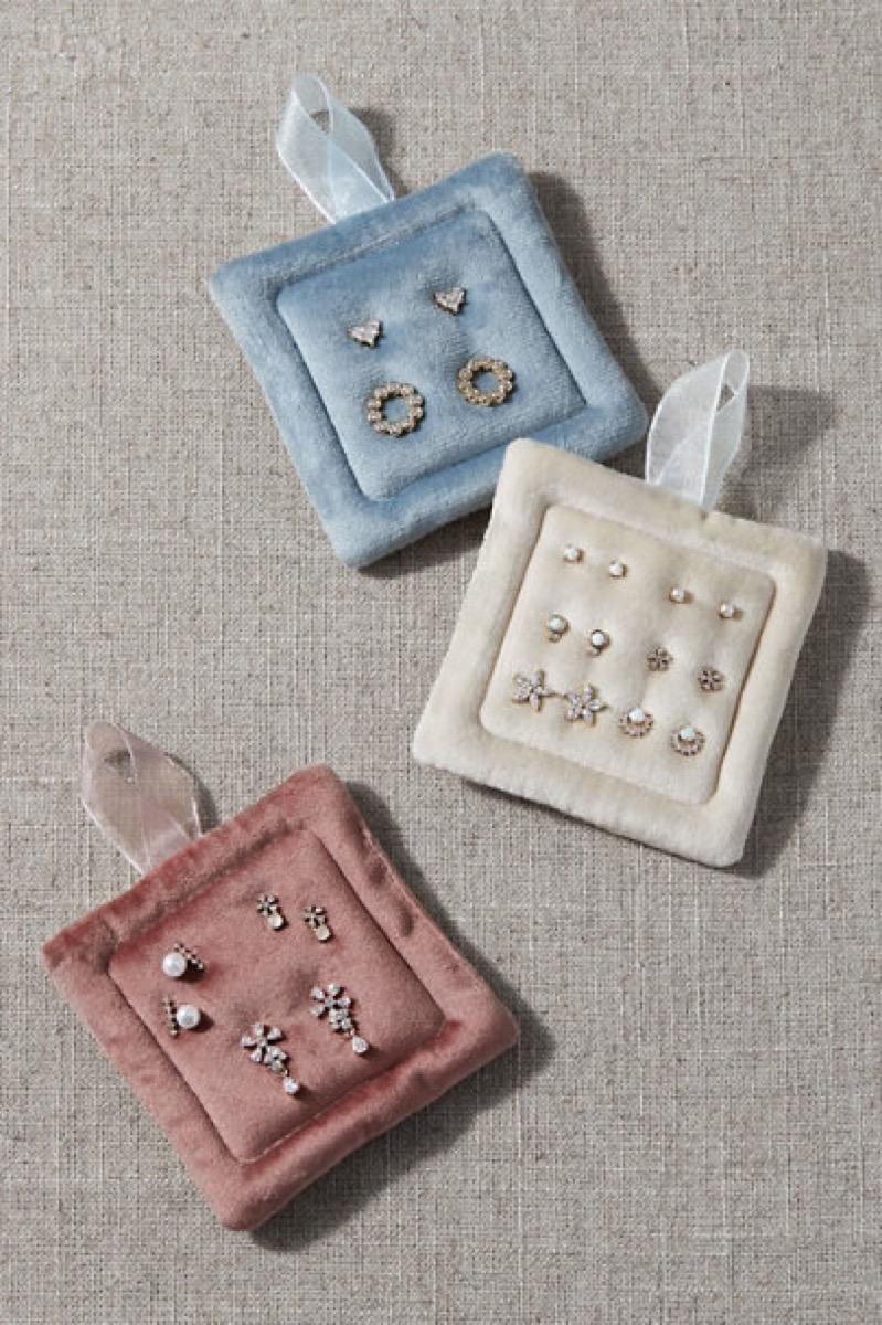 Earring sets on three velvet earring holders