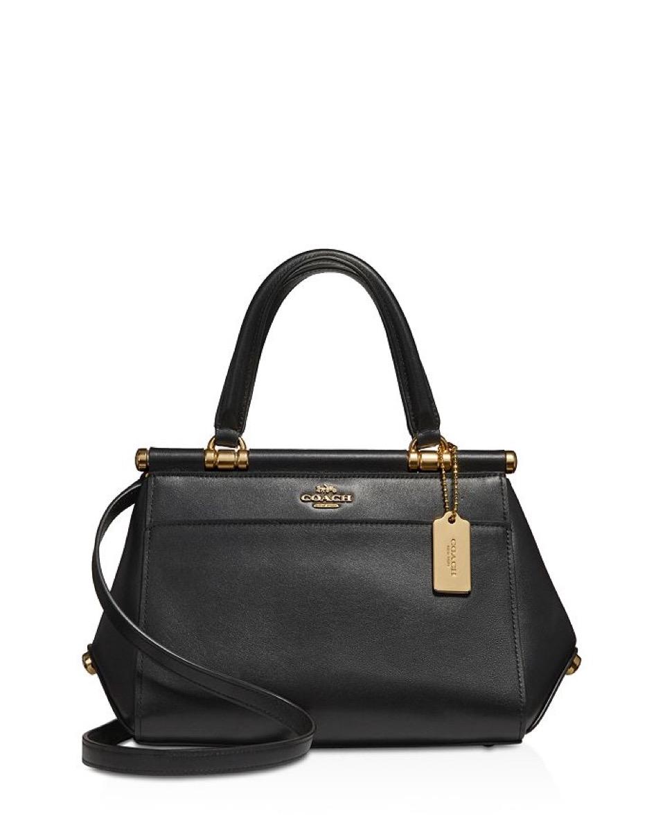 Black coach purse white background