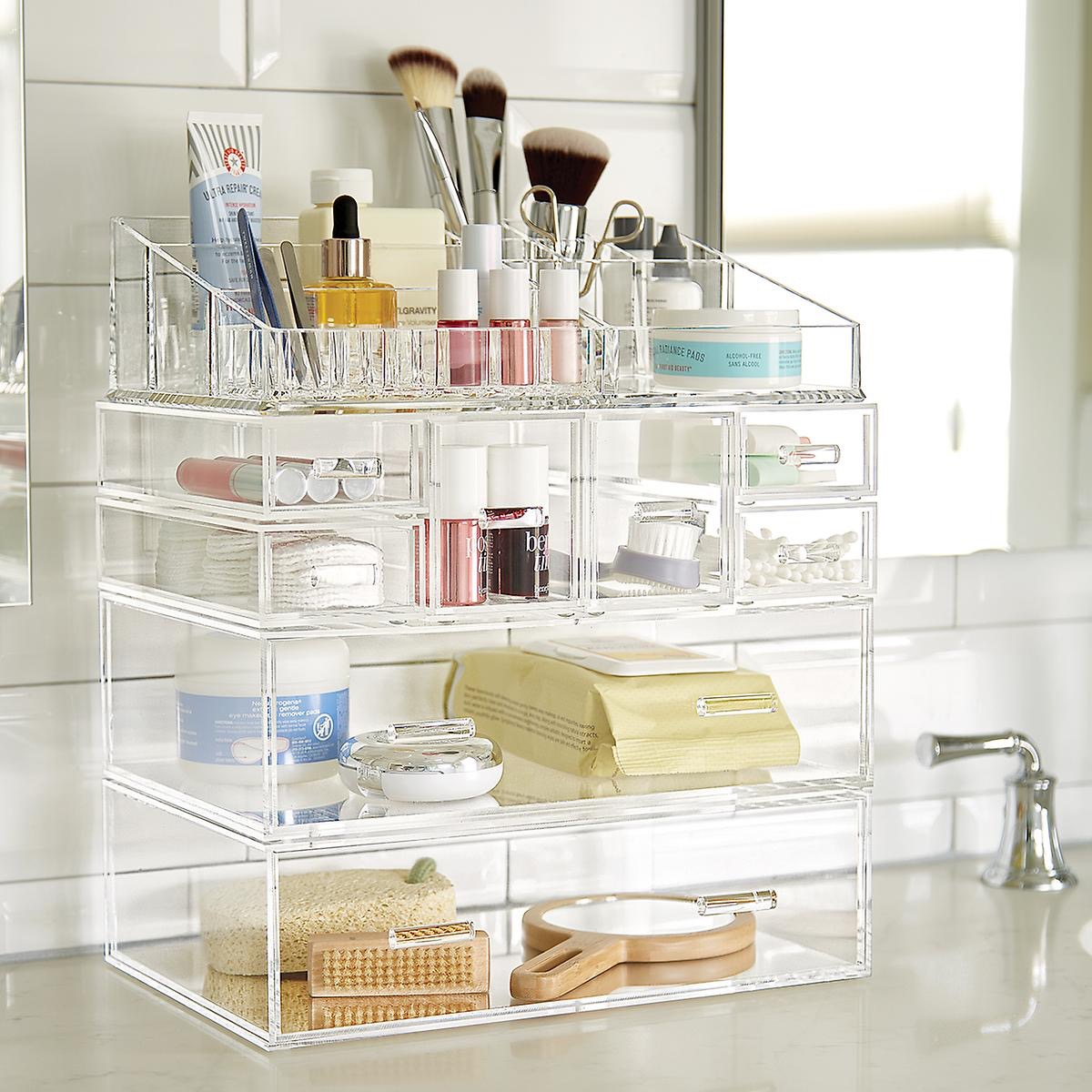 Clear acrylic case with makeup on counter