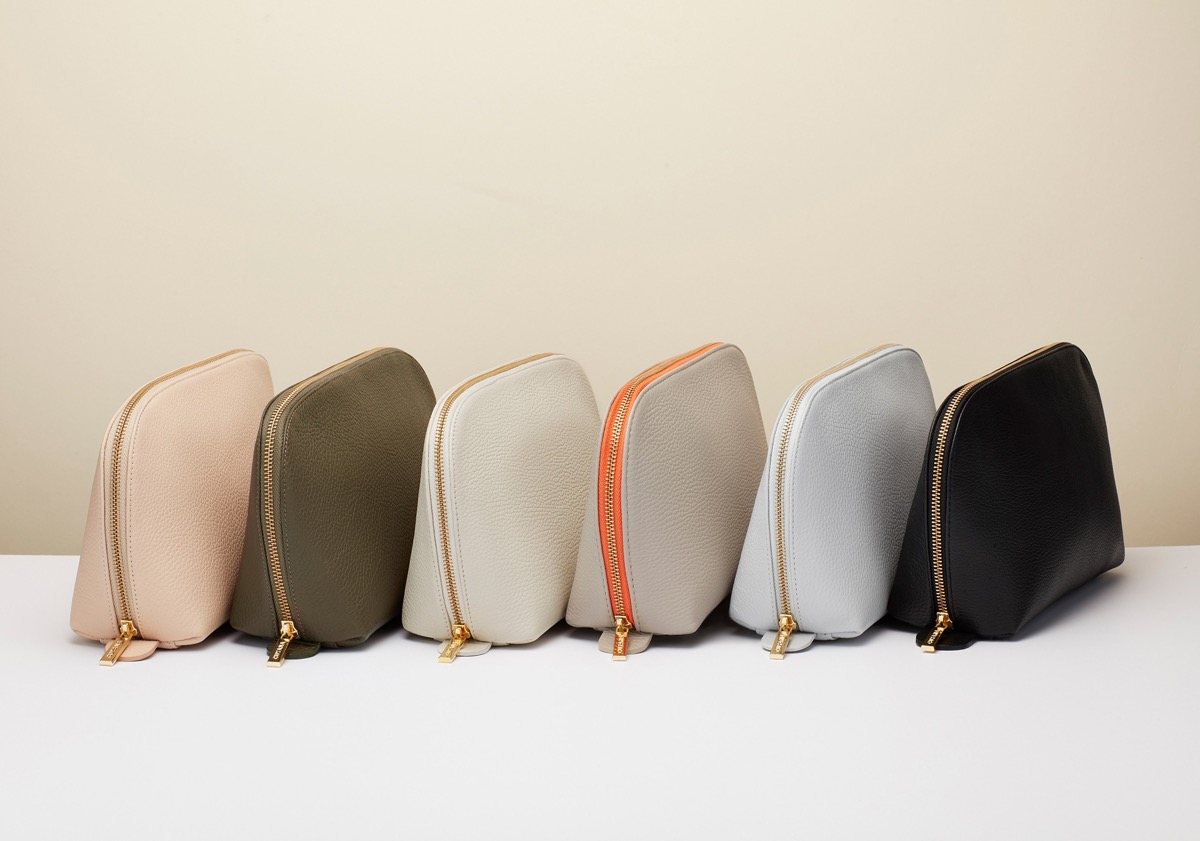 Row of travel bags in various colors