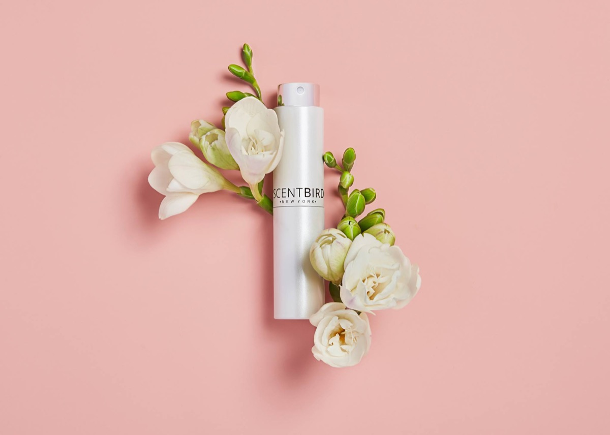 white scentbird bottle with flowers