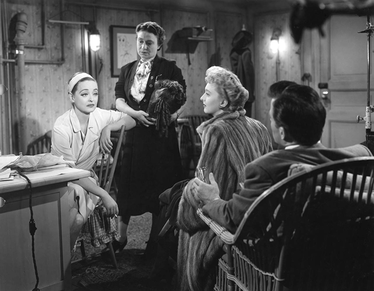 Bette Davis and cast in dressing room on the set of All About Eve
