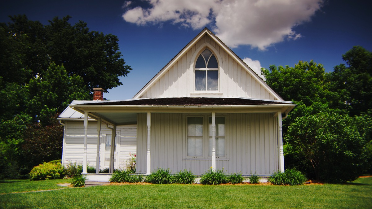 american gothic farm house in the summer