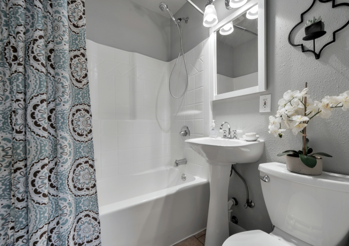 bathroom with patterned shower curtain
