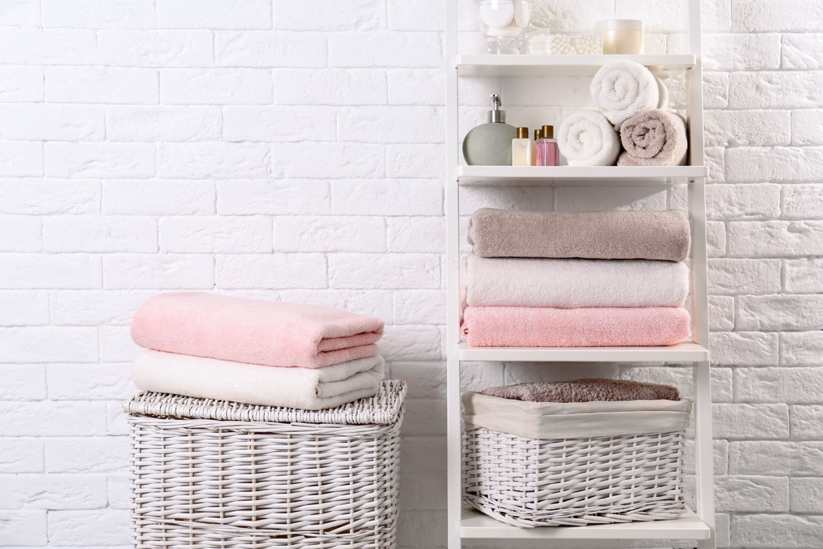 Bathroom shelves storage with pink towels
