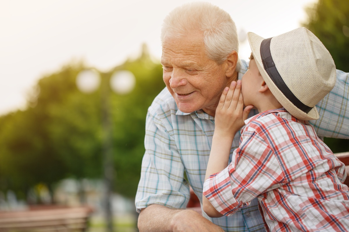 white boy whispering to grandpa