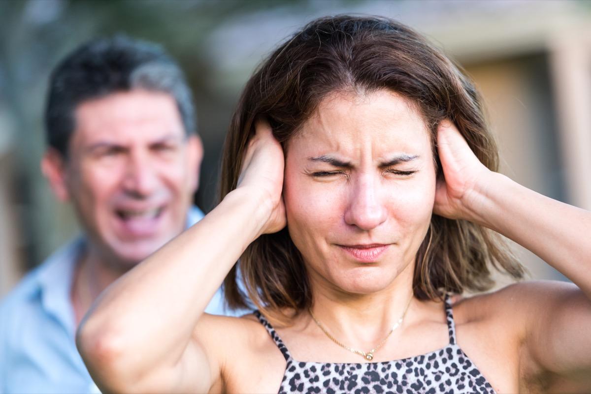 boyfriend yelling at his upset girlfriend