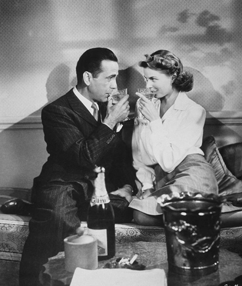 Ingrid Bergman and Humphrey Bogart sharing a drink in Casablanca