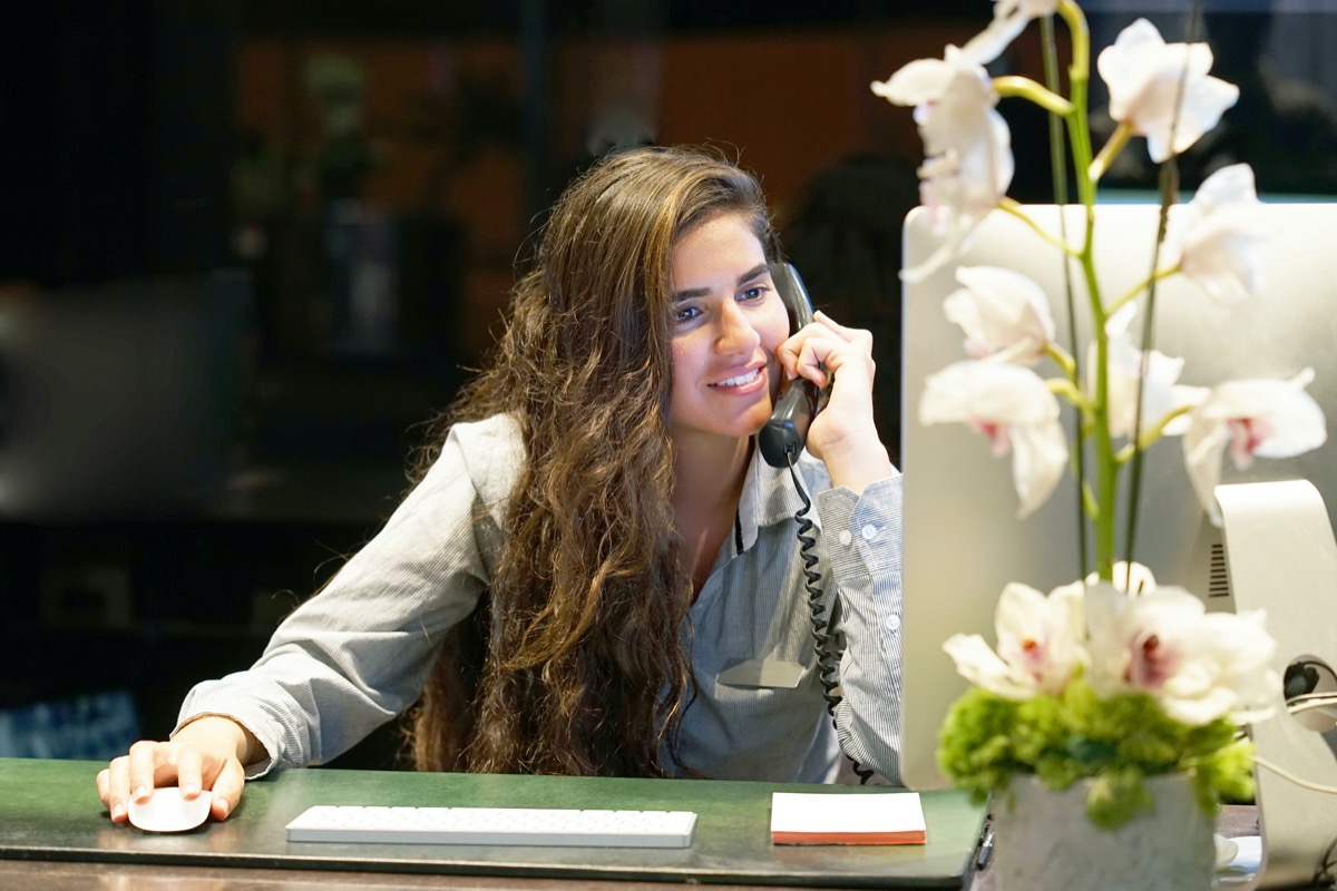 hotel concierge on computer