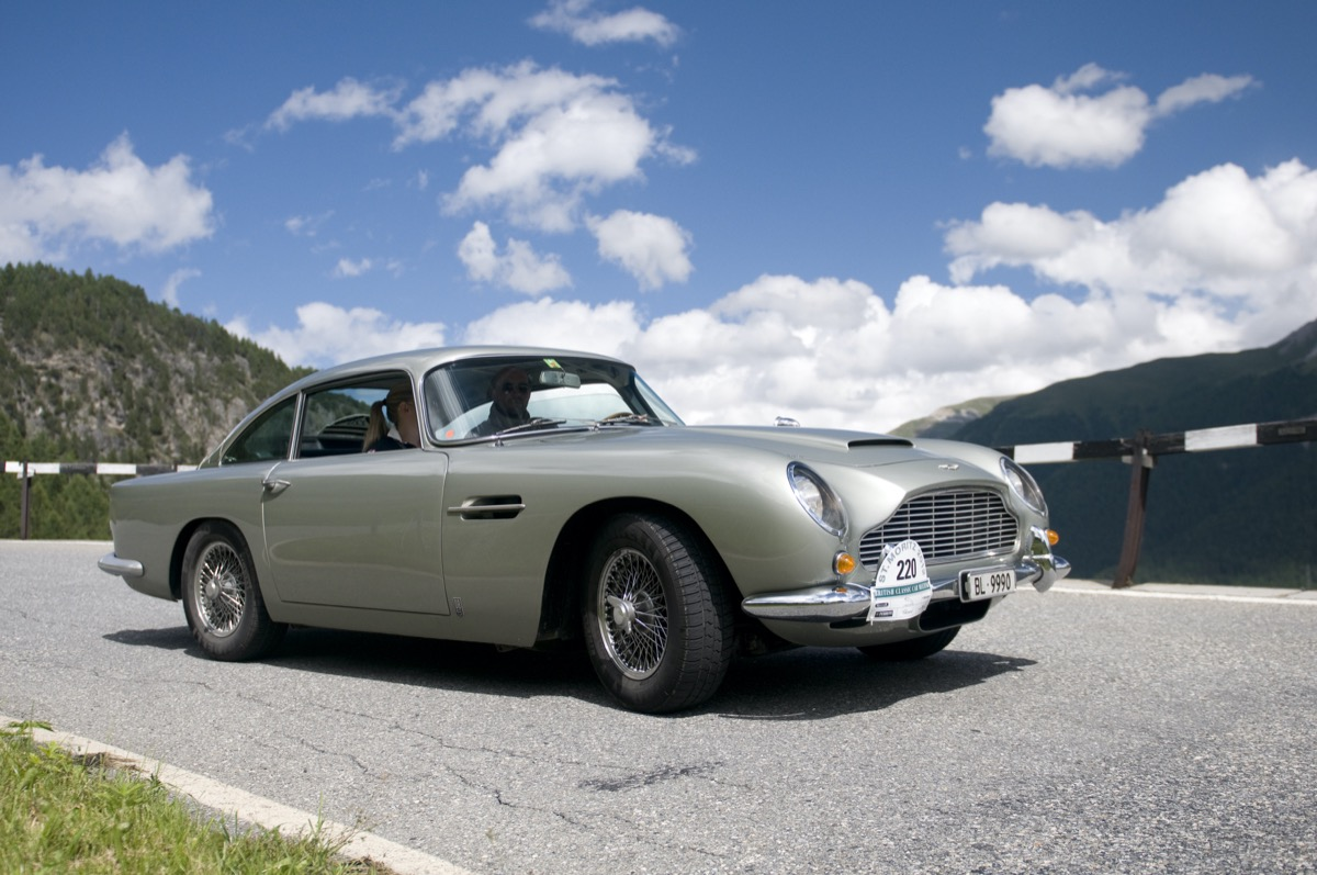 Two participants, a driver and his passenger from the British Classic Car Meeting in St. Moritz, riding in a Aston Martin DB5 manufactured in 1965, the Albula Pass down. The rally route of the 19th BCCM St. Moritz performs on Saturday 14 July 2012, from St. Moritz over the FlAelapass to Davos and Lenzerheide, and then over the Albula Pass BergAn and back to St. Moritz
