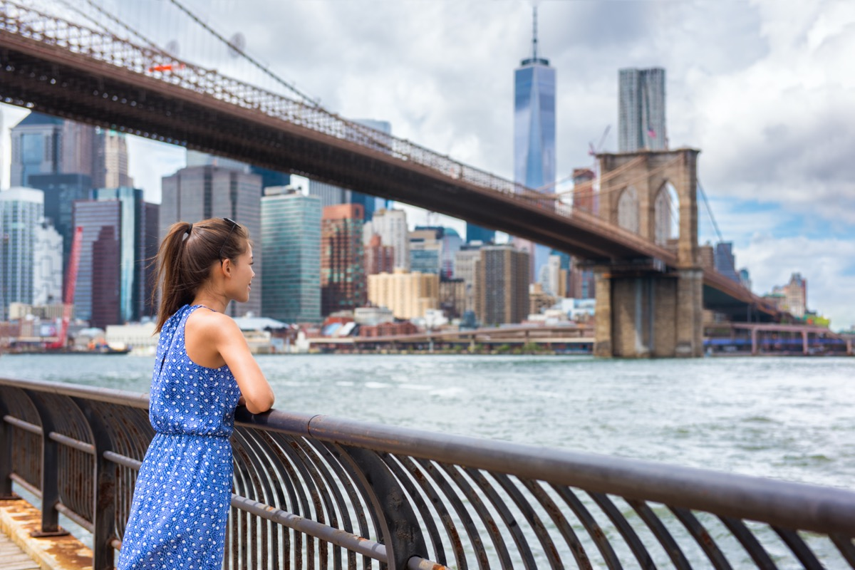 woman looking over nyc's skyscrapers