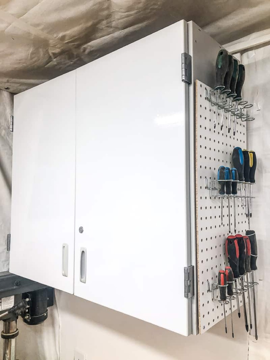 white cabinet with tools on the side