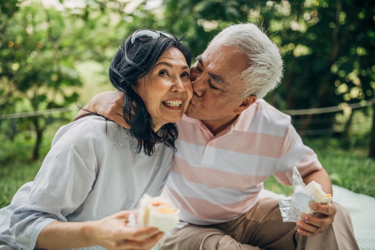 older asian couple kissing