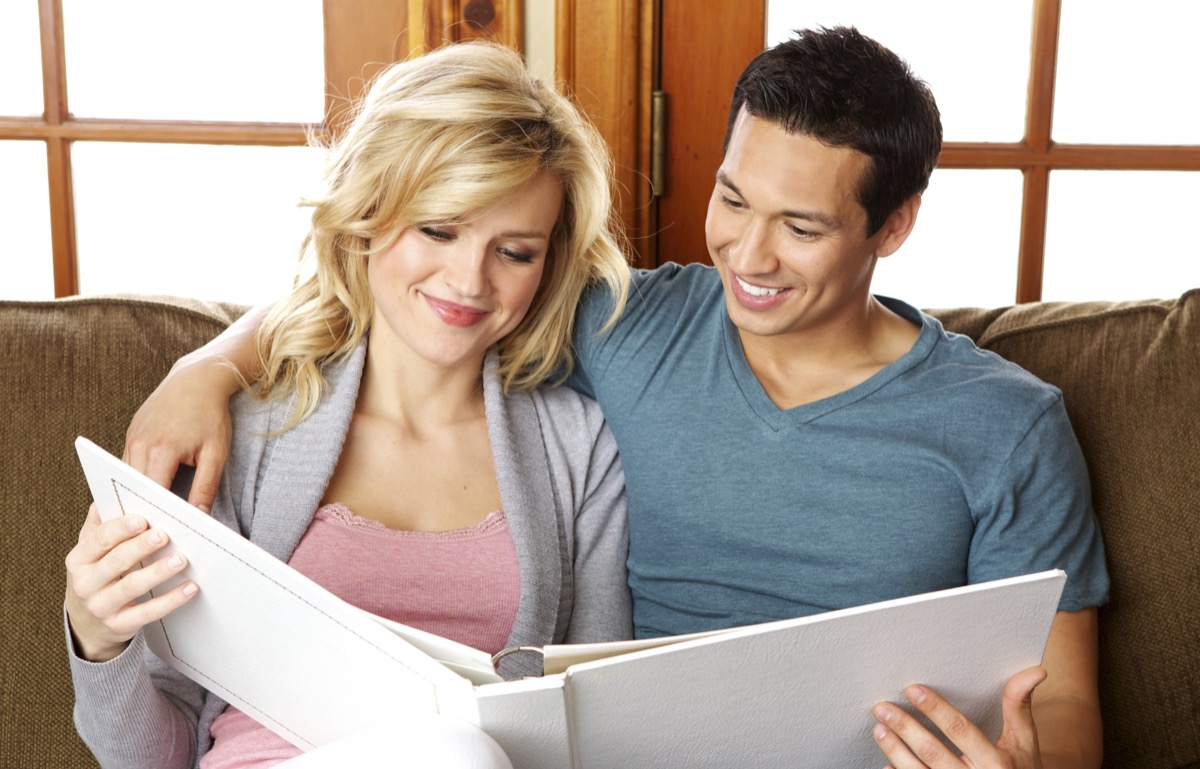Couple looking at a photo album together