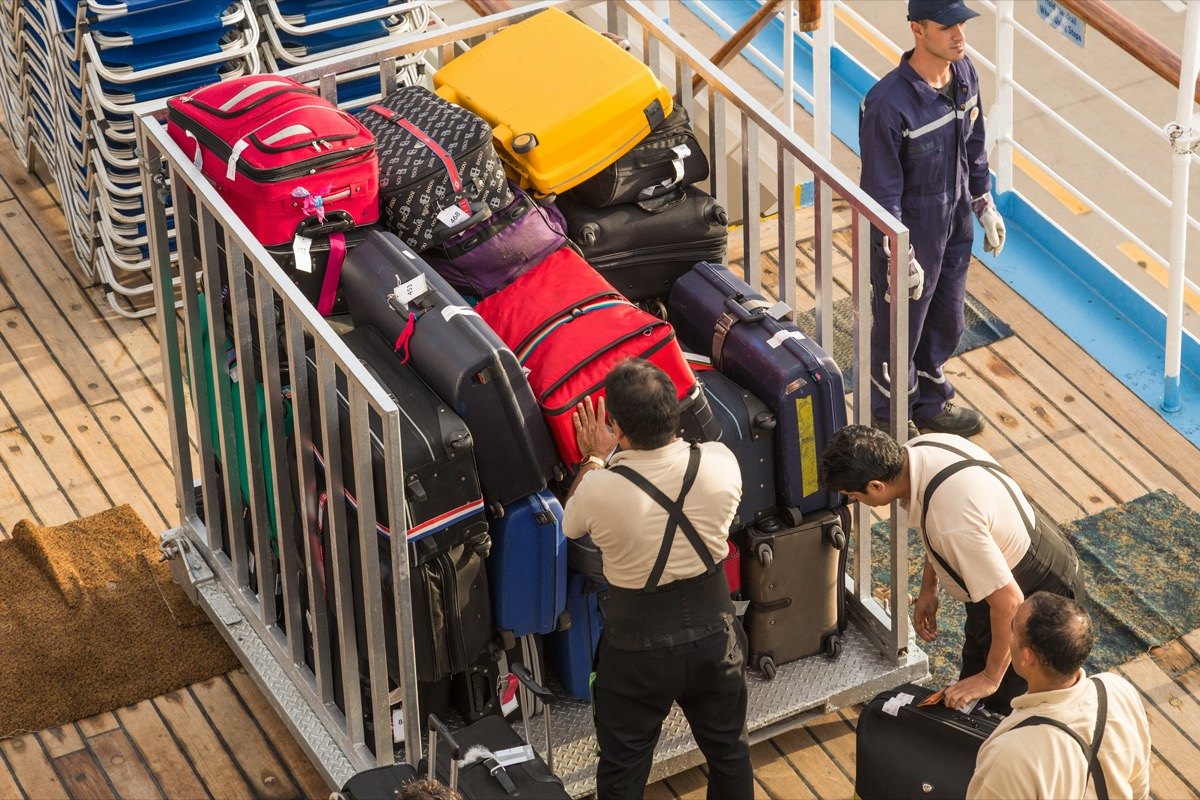 cruise workers unloading luggages