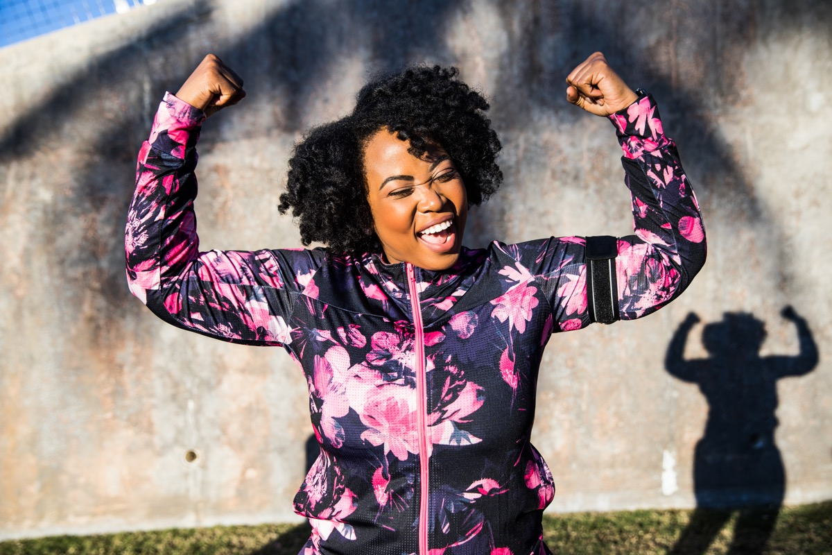 Funny portrait of a young black curvy woman during a training workout session