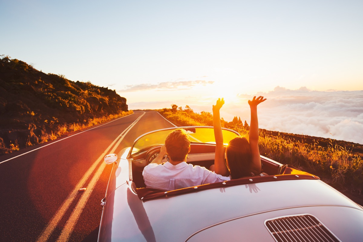 Couple taking a day trip driving down the highway