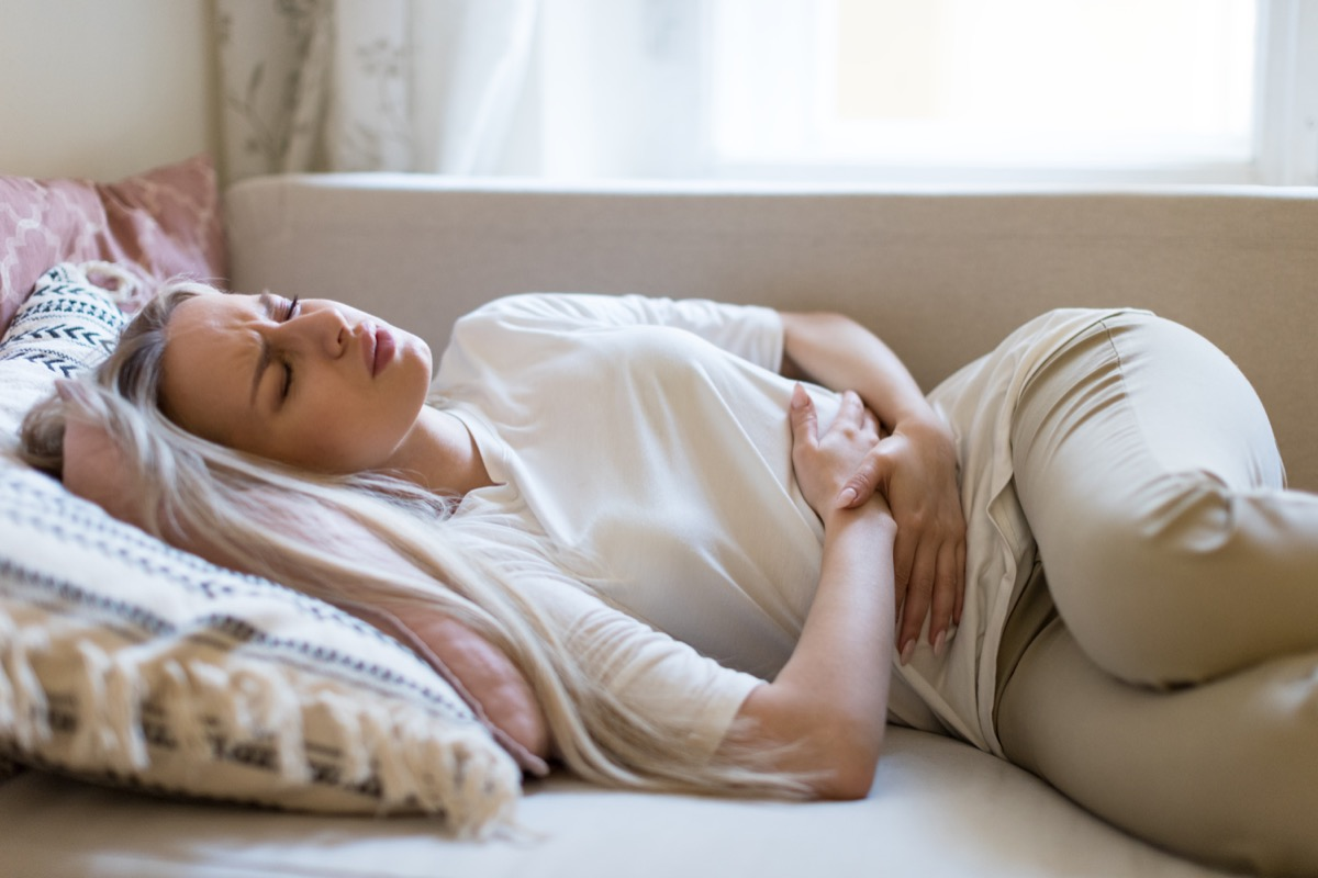 Woman in discomfort experiencing digestive issues