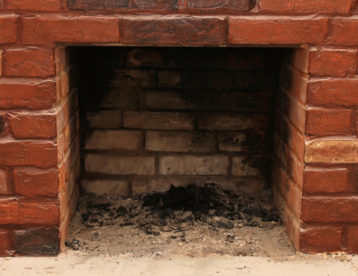dirty brick fireplace