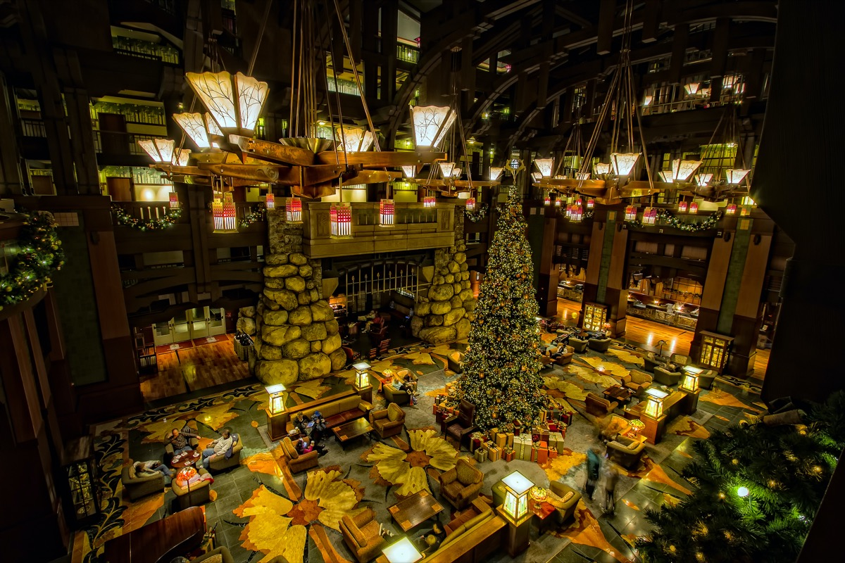 the inside of disney grand californian hotel during christmas