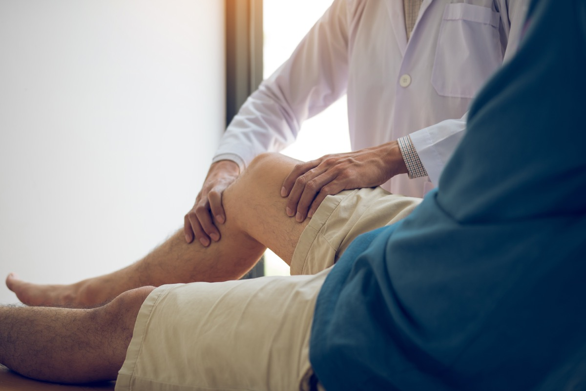 Doctor checking on patient's weak knee muscle