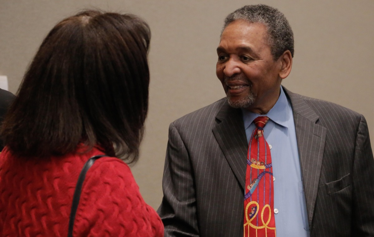 Dr. Frank Smith civil rights activist, historian, politician, museum founder, and keynote speaker at the Naval Surface Warfare Center Dahlgren Division sponsored 2018 African-American and Black History Month Observance – talks with a member of the audience after his keynote speech about the history and heroes of American civil rights and the Civil War. The civil rights activist is most recognized as the first person associated with the Student Nonviolent Coordinating Committee who registered voters in Mississippi.