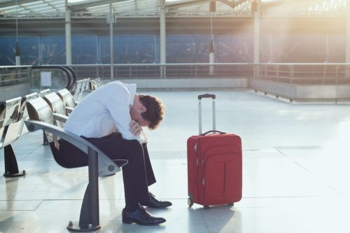 man tired from early morning flight