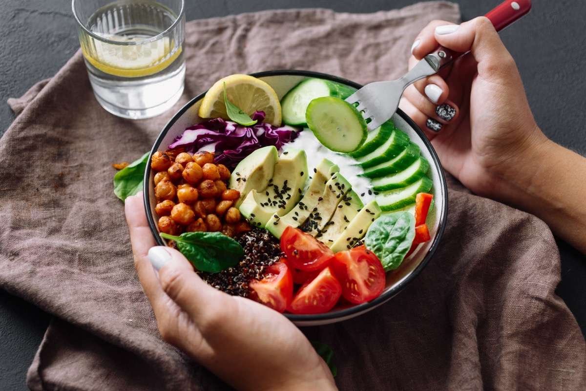 Bowl of colorful salad and a lemon water