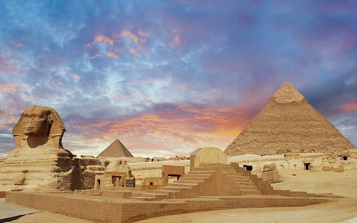 a view of the Egyptian pyramids at dusk