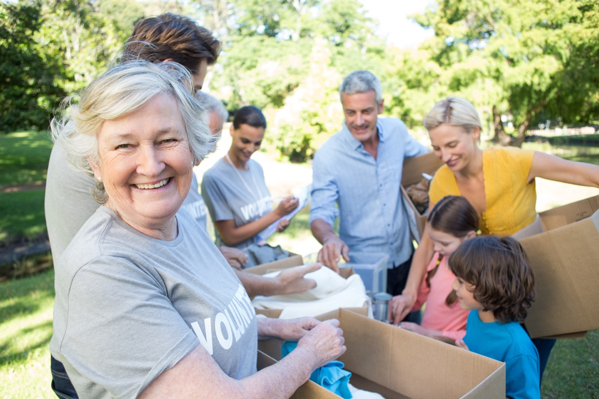 Older woman and family volunteering collecting donations