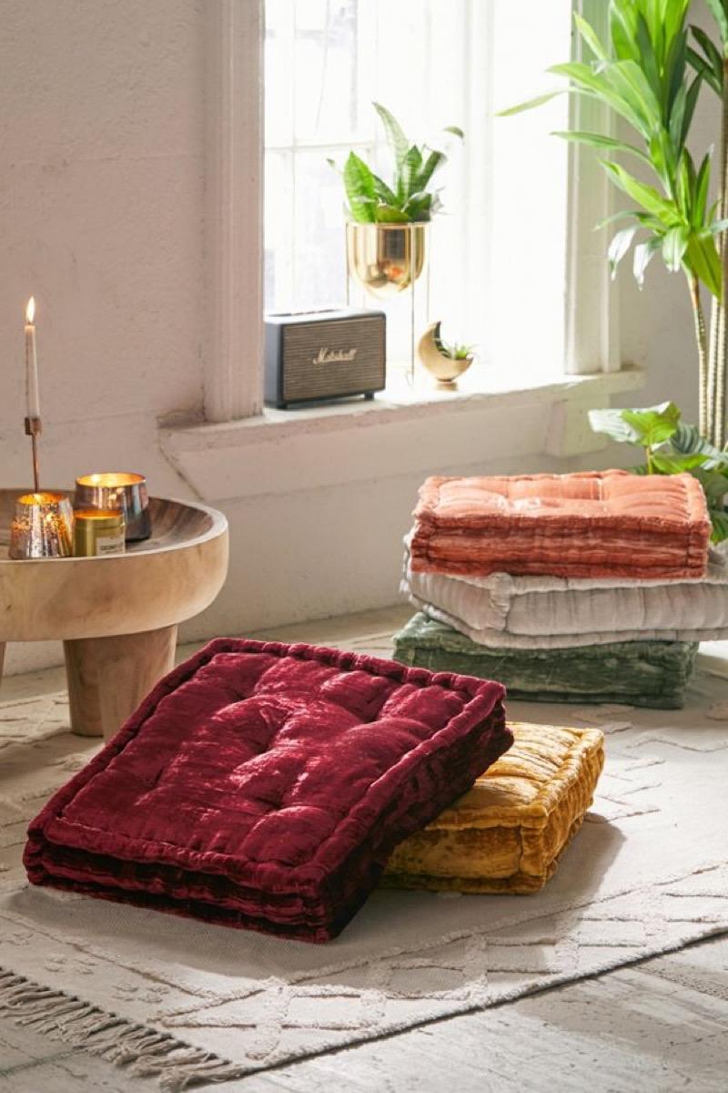 two velvet floor cushions in twee room