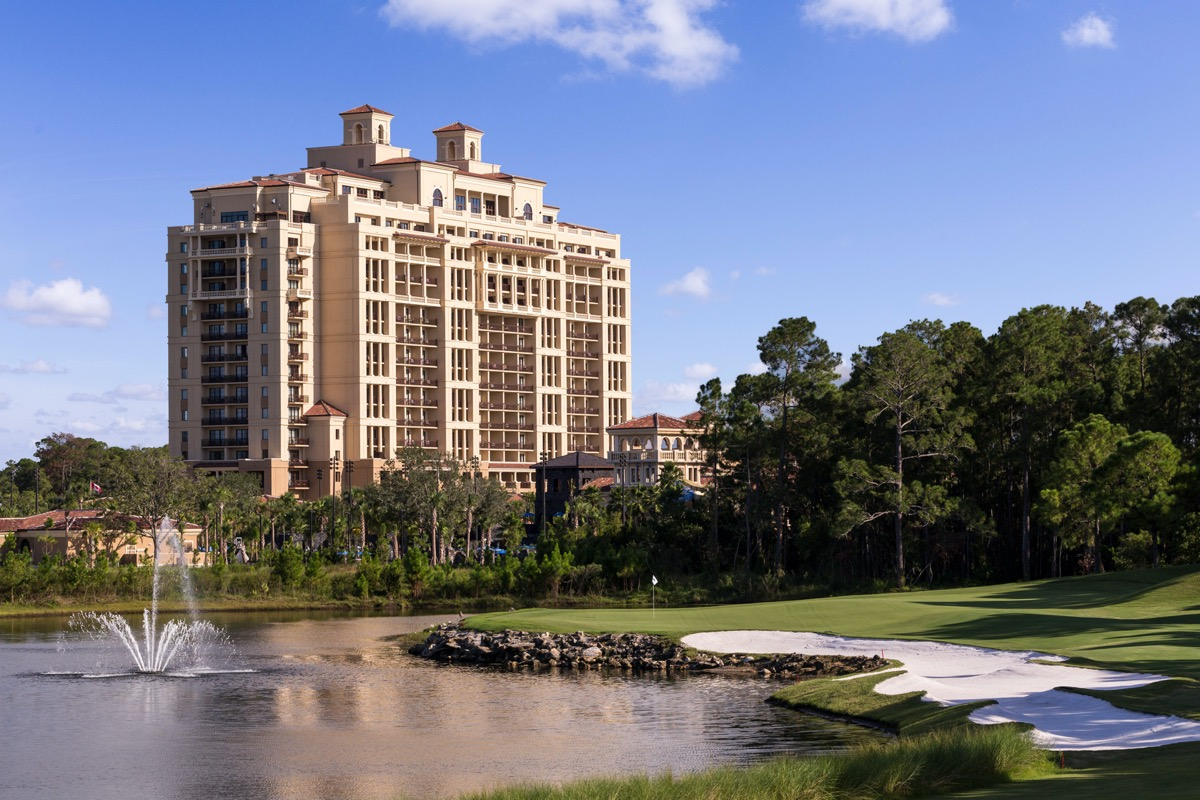 golf course with the four seasons disney resort in the background