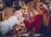 Sweet couple having a romantic dinner with wine