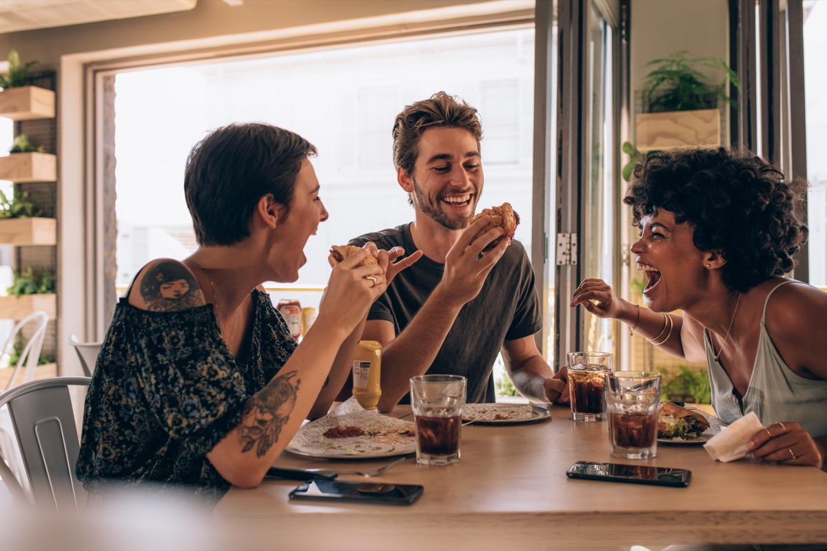 Friends laughing and eating
