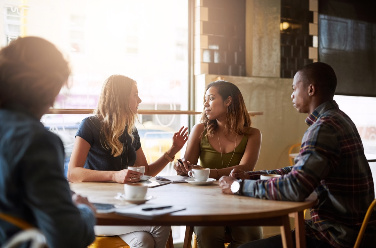 Shot of a group of friends catching up over coffee in a coffee shop