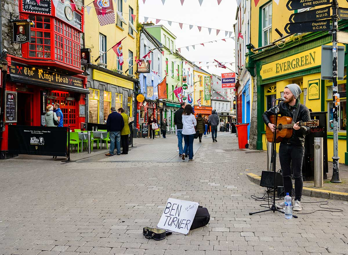 a musician plays on a street in ireland