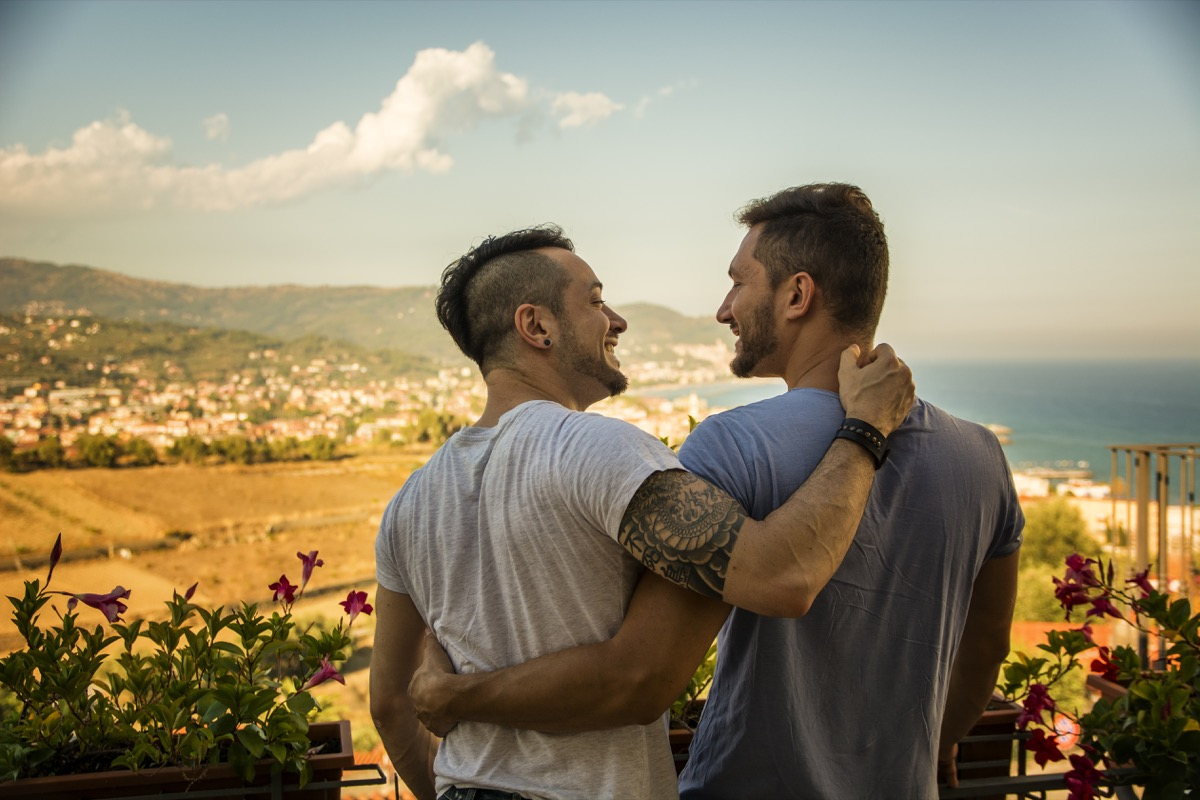 Gay couple hiking on vacation