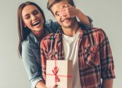 Girl surprising guy with gift