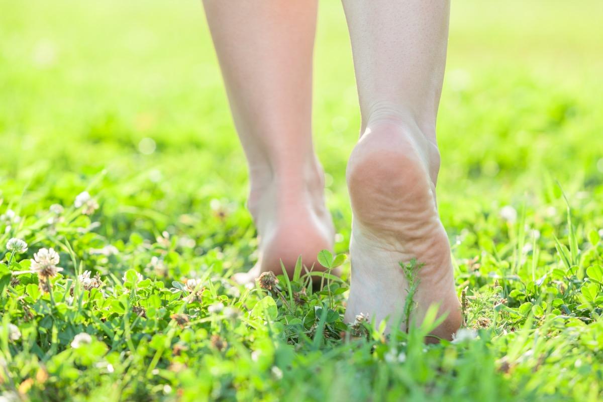 Feet walking in grass