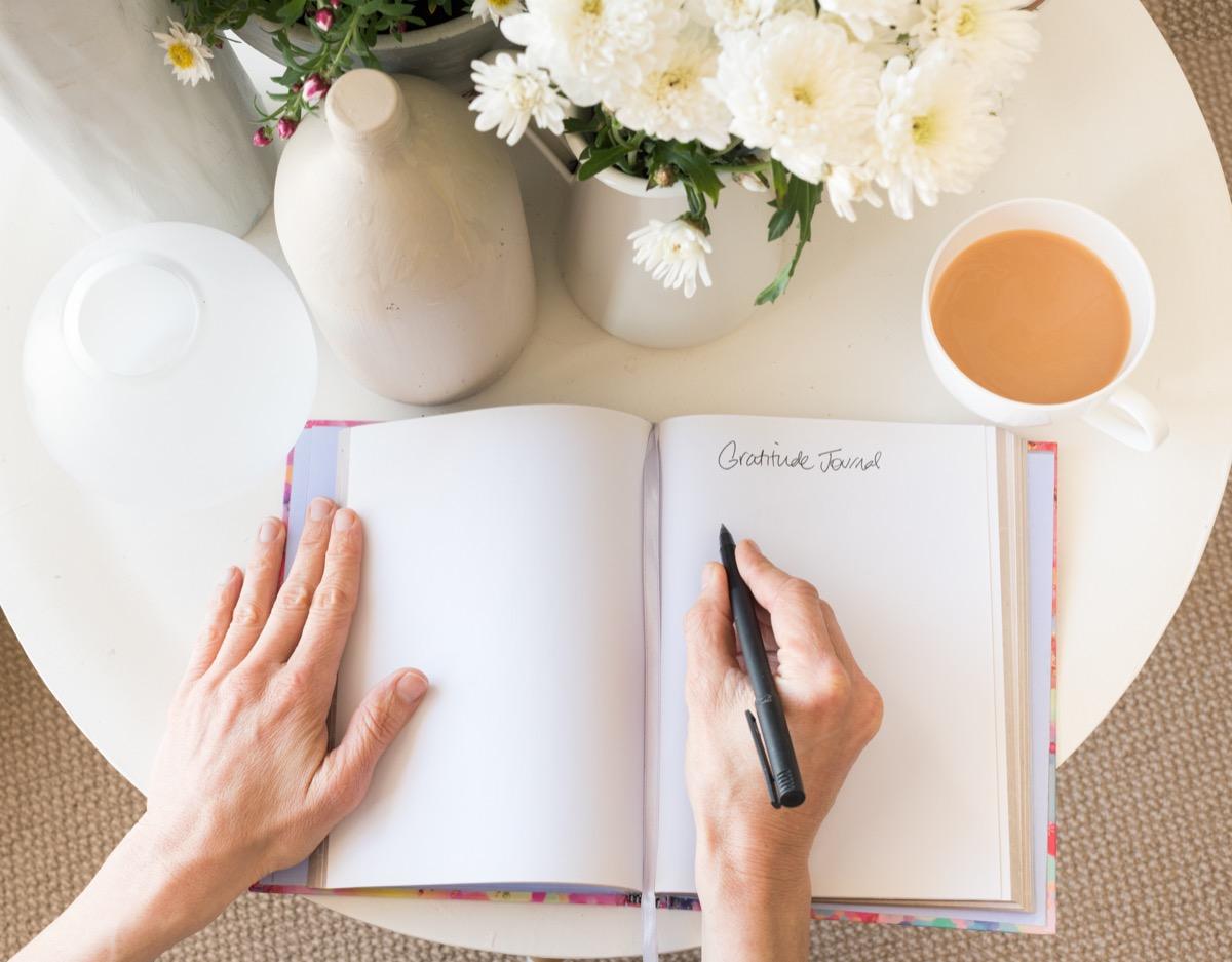 Woman using a gratitude journal