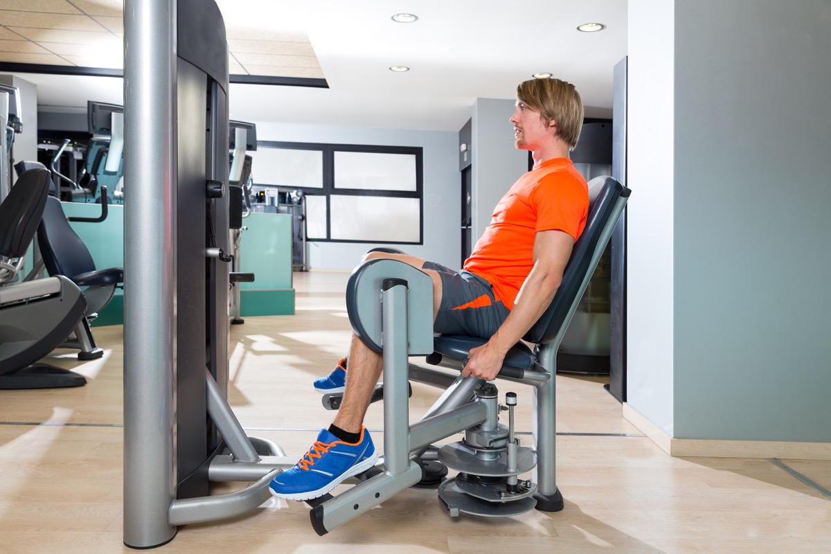 Man at the gym using a hip abduction machine