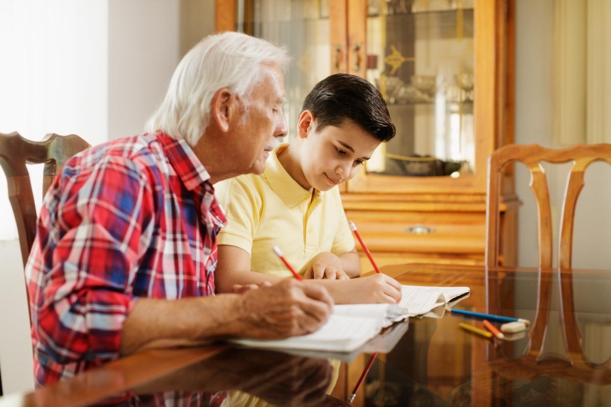 grandpa and grandson doing homework
