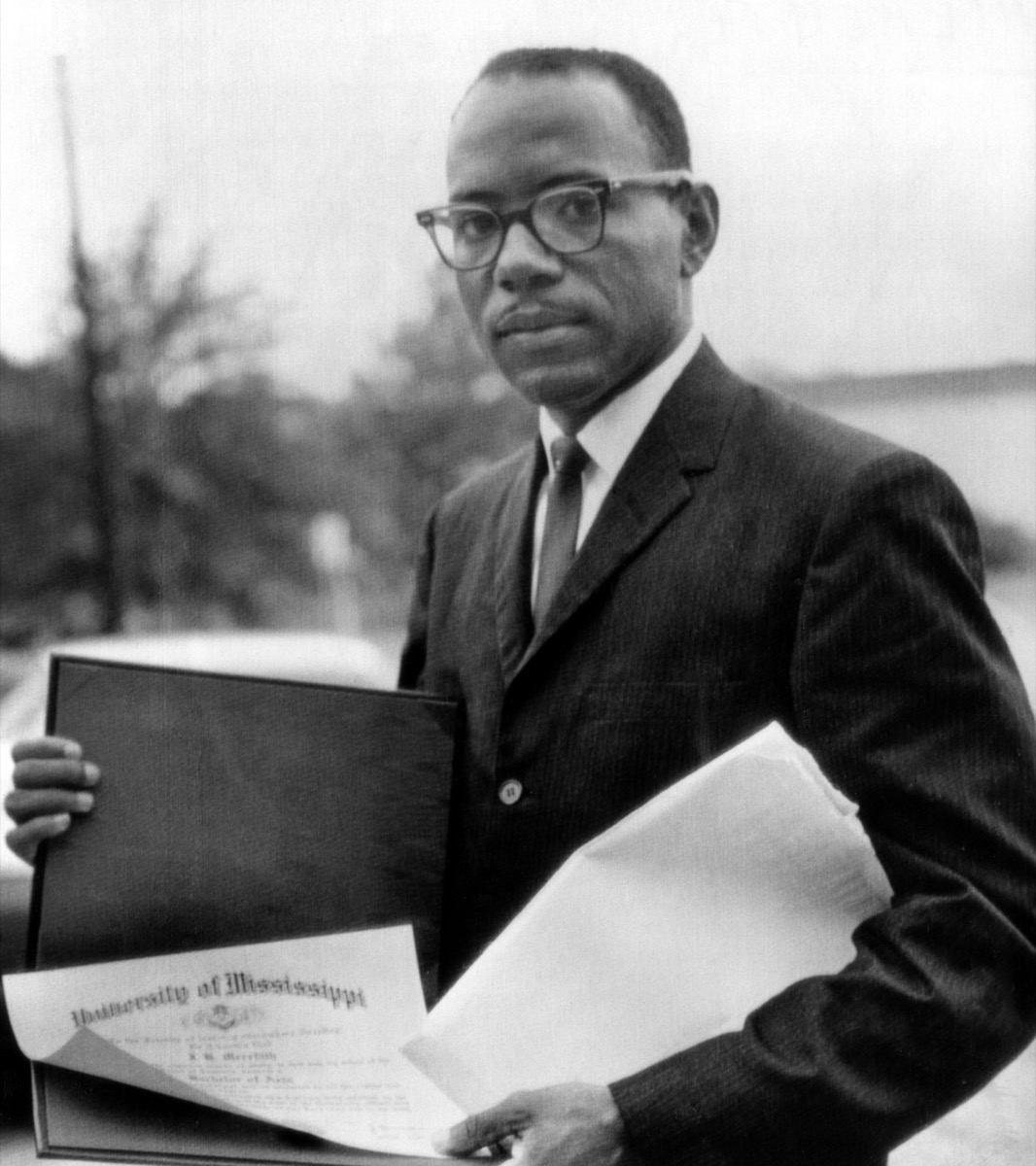 James Meredith, first African American to ever enroll and graduate from the University of Mississippi displays his diploma