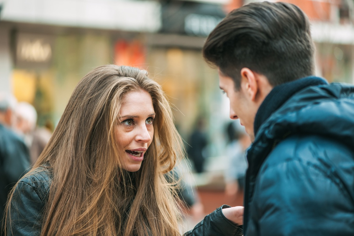 young couple quarreling because of disagreements - outdoors