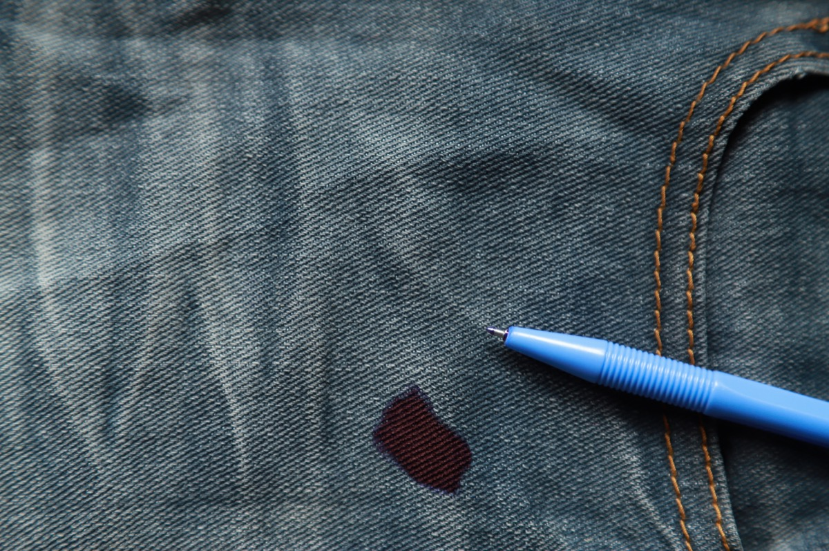 jeans with pen on them and red ink stain