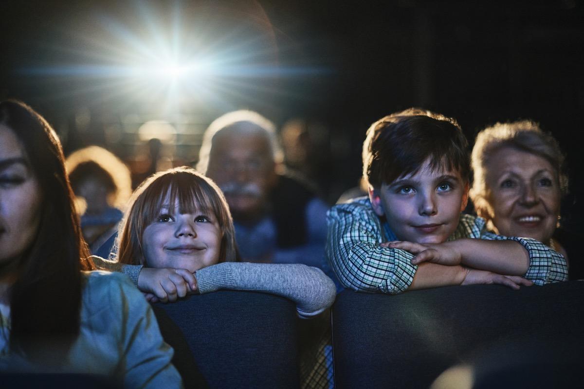 Grandparents taking their grandchildren to the theater